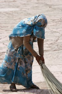 Woman sweeping--our drivers could tell us a person's caste by seeing what they do